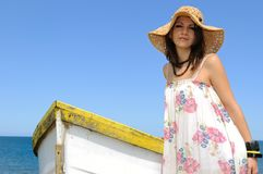 Young woman and rowboat. Stock Photos