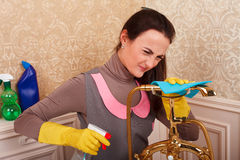 Young woman in rubber gloves cleans bathroom Stock Photos