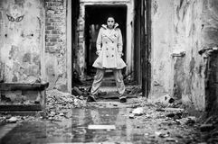 Young woman in a ruined building Stock Photography
