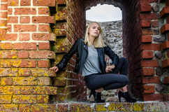 Young woman in ruins Stock Images