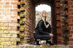 Young woman in ruins Stock Photo