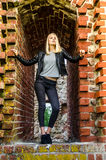 Young woman in ruins. A dramatic portrait of a beautiful young caucasian woman standing in an abandoned building/ruins Royalty Free Stock Photo