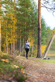 Young woman run in autumn the forest sunset lights. Young woman run in autumn the forest in sunset lights royalty free stock images