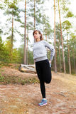 Young woman run in autumn the forest sunset lights. Young woman run in autumn the forest in sunset lights royalty free stock photo