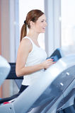 Young woman at the run at gym Royalty Free Stock Photography
