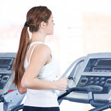 Young woman at the run at gym Royalty Free Stock Images