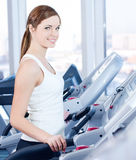 Young woman at the run at gym Stock Image