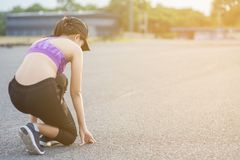 Young woman runner is jogging on the street be running for exercise. stock images