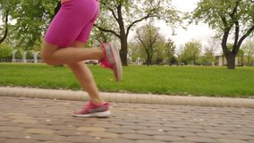 Young woman runner legs running on track stock video