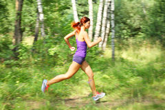 Young woman runner. Moton blur Stock Photo
