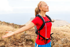Young woman runner in mountains Royalty Free Stock Photo