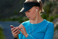 Young woman runner with mp3 player,  fitness training Stock Images
