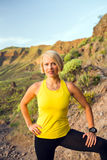 Young woman runner portrait on mountain trail Stock Image