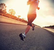 Young woman runner running on city Royalty Free Stock Photo