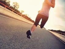Young woman runner running Stock Photos