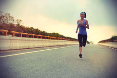 Young woman runner running Stock Image