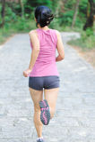 Woman runner running Stock Images
