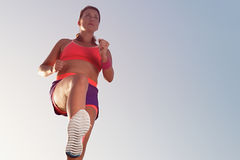 Young woman runner running,training for marathon run. View from below Stock Image