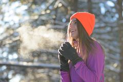 Young Woman Runner Smiling in Beautiful Winter Forest at Sunny Frosty Day. Active Lifestyle and Sport Concept. stock image