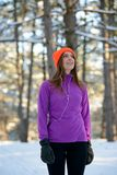 Young Woman Runner Smiling and Looking Up in Beautiful Winter Forest at Sunny Frosty Day. Active Lifestyle and Sport. Royalty Free Stock Images