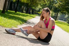 Free Young Woman Runner Touching Foot In Pain Outdoors Royalty Free Stock Photo - 103481035
