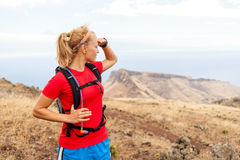 Young woman runner on trail in mountains Stock Images