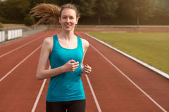 Young woman runner training on a track Royalty Free Stock Photos