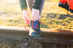 Young woman runner tying shoelaces with copy space, healthy lifestyle and sport concepts. stock image