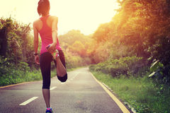 Young woman runner warm up Royalty Free Stock Photo
