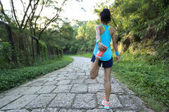 Young woman runner warm up Stock Image