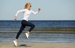 Young woman running Stock Photos