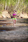 Young woman running Royalty Free Stock Photography