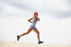 Young woman running Stock Photography