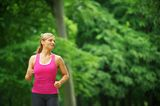 Young woman running alone in the park Royalty Free Stock Photography
