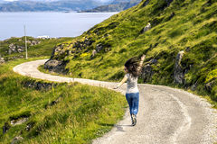 Young woman running along the countryside road Royalty Free Stock Photos
