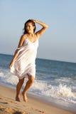 Young Woman Running Along Summer Beach Stock Images