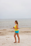 Young woman running on the beach Royalty Free Stock Photography