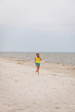 Young woman running on the beach Stock Photography