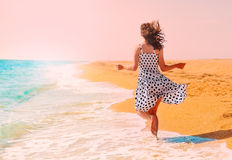 Young woman running on the beach Royalty Free Stock Image