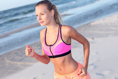Young woman running on the beach Royalty Free Stock Images
