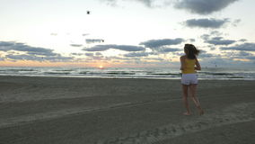 Young woman running on the beach stock video footage