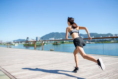 Young Woman running in city Royalty Free Stock Photos