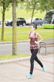 Young Woman Running Through the City of Bilbao. Stock Images