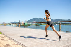 Young Woman running in city of Hong Kong Stock Images