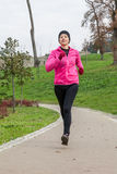 Young woman running on a cold winter day Royalty Free Stock Photography