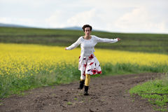 Young woman running on a countryside road. Freedom concept Stock Images