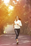 Young woman running Stock Image