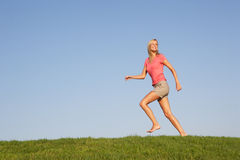 Young woman running through field Royalty Free Stock Photo