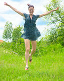 Young woman running on  grass Royalty Free Stock Photo