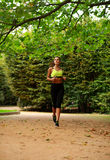 Young woman running in green park, fitness outdoor Stock Photography